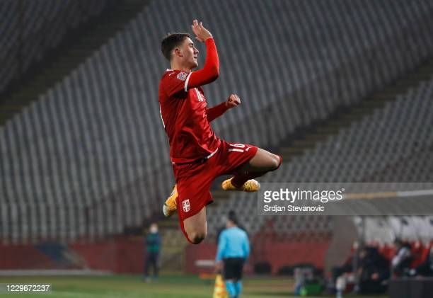 Dusan Vlahovic of Serbia celebrates after scoring the third goal of his team during the UEFA Nations League group stage match between Serbia and...