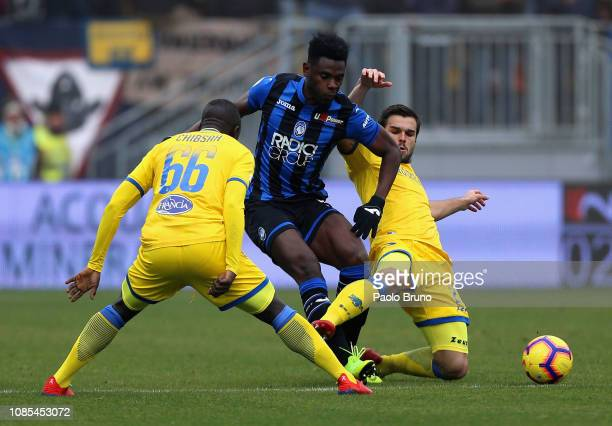 Dusan Zapata of Atalanta BC competes for the ball with Raman Chibsah and Nicolo' Brighenti of Frosinone Calcio during the Serie A match between...