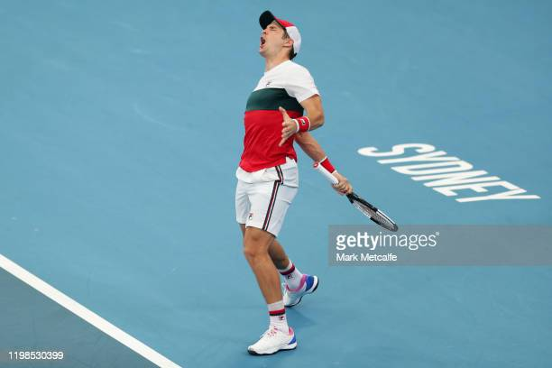 DusanLajovic of Serbia celebrates winning match point during his quarter final singles match against Felix Auger Aliassime of Canada during day...
