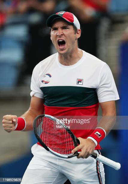 DusanLajovic of Serbia celebrates winning set point during his quarter final singles match against Felix Auger Aliassime of Canada during day eight...