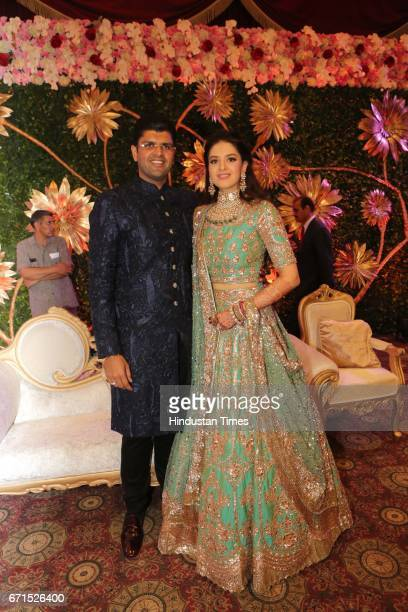 MP Dushyant Chautala with Meghna Ahlawat during their wedding reception at Ashoka Hotel on April 20 2017 in New Delhi India Dushyant Chautala is the...