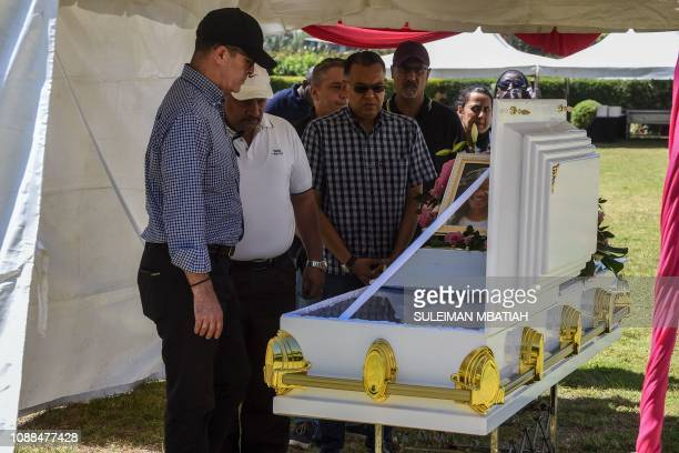 Dusit hotel complex General Manager Michael Metaxas reacts beside the coffin of Trufosa Nyaboke who was among those killed during a terror attack at...