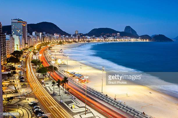 Dusk at Copacabana beach view from above of traffic at Atlantica avenue Copacabana promenade with Sugar Loaf mountain in background The promenade is...