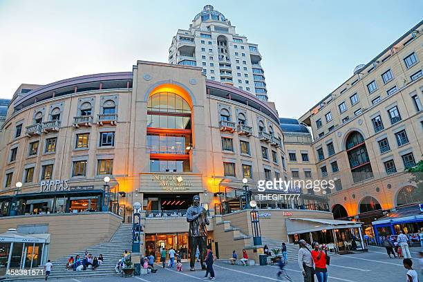dusk at nelson mandela square - sandton stock pictures, royalty-free photos & images