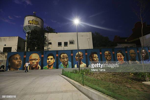 Dusk descends over a new mural of street art honoring the first Olympic refugee team during the Rio 2016 Olympic Games on August 17, 2016 in Rio de...