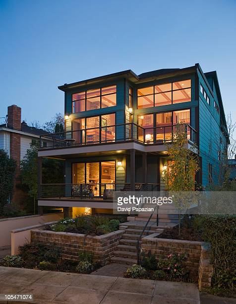 Dusk exterior of modern multi-story house