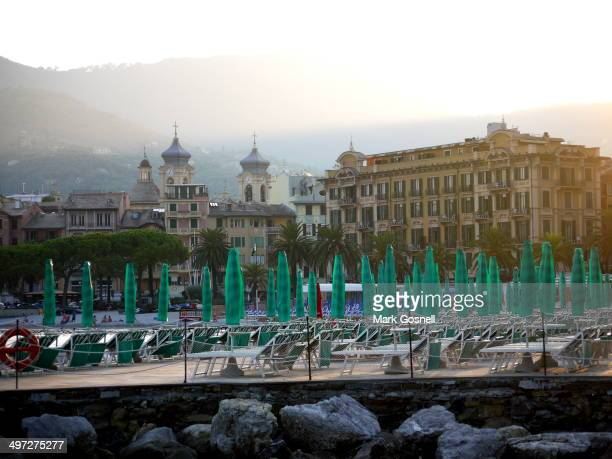Dusk falls on Portofino as the sun umbrellas and loungers have been closed up for the night