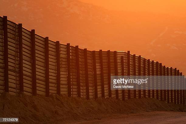 Dusk falls over a section of the USMexico border fence which activists opposing illegal immigration hope will be turned into a fullylit doublefenced...