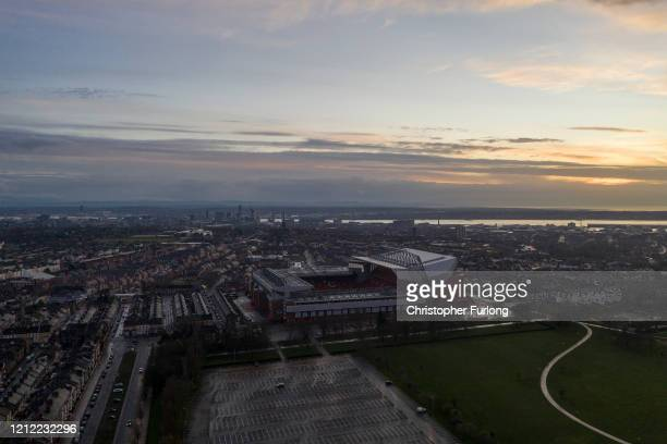Dusk falls over Anfield Stadium, the home Liverpool Football Club on March 13, 2020 in Liverpool, United Kingdom. It has been announced that all...