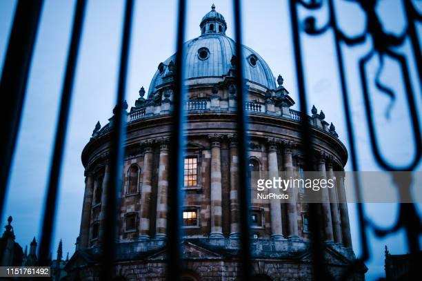 Dusk falls over the historic Radcliffe Camera library building in Oxford England on June 22 2019