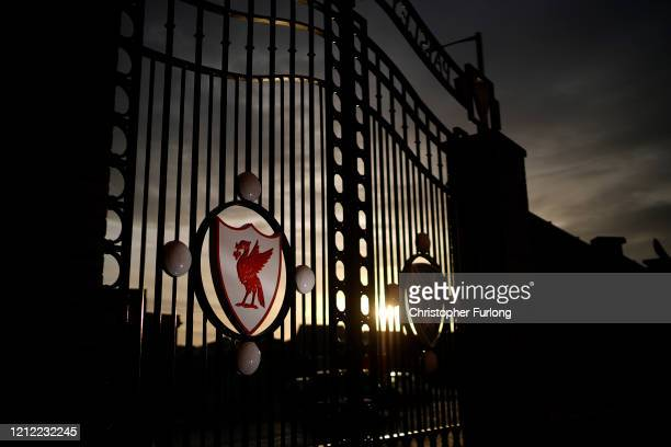 Dusk falls over The Paisley Gates at Anfield Stadium, the home Liverpool Football Club on March 13, 2020 in Liverpool, United Kingdom. It has been...