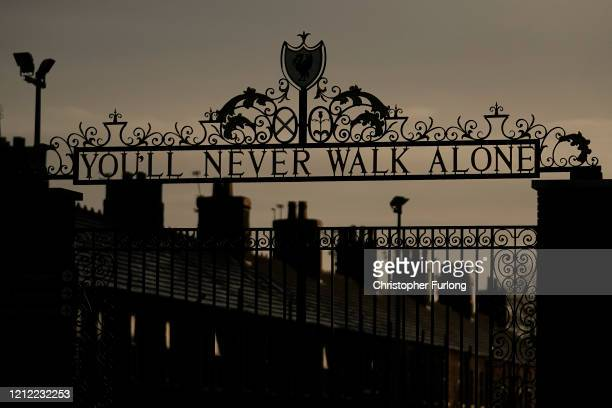 Dusk falls over The Shankly Gates at the home of Liverpool Football Club on March 13 2020 in Liverpool United Kingdom It has been announced that all...