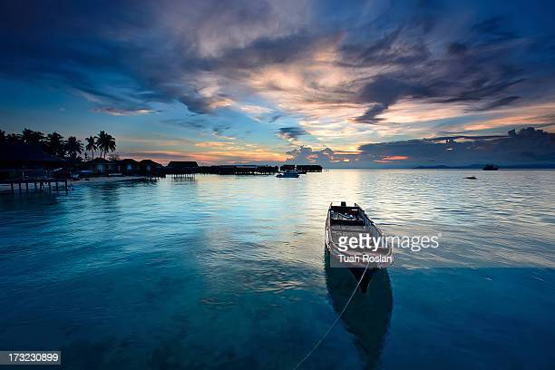 dusk in mabul with boat - mabul island stock photos and pictures
