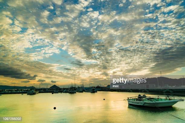 dusk in naoshima port - kagawa ストックフォトと画像
