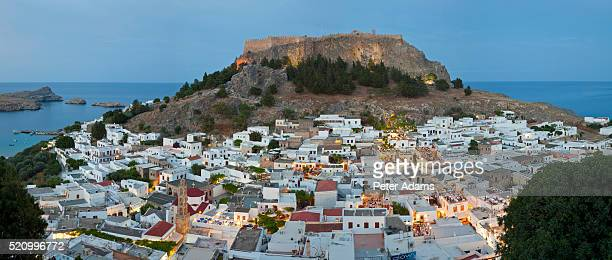 dusk, lindos, rhodes island, dodecanese islands, greece - lindos stock photos and pictures