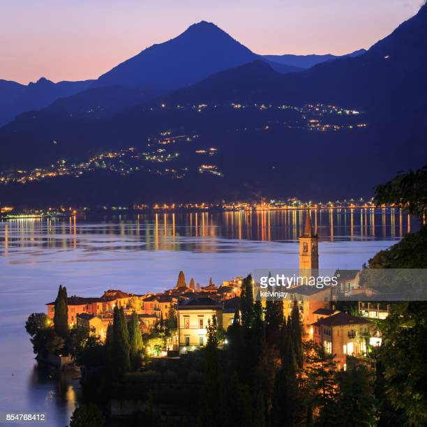 dusk looking over varenna on lake como, italy - lombardy stock pictures, royalty-free photos & images