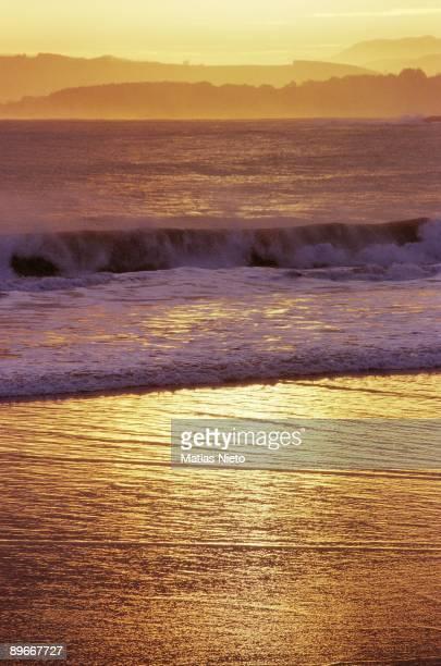 Dusk on a beach Detail of the evening in the Sardinero beach Santander