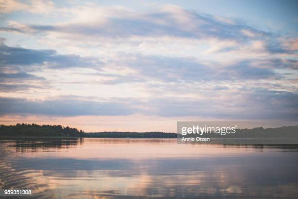 dusk on a minnesota lake - sunset lake stock photos and pictures