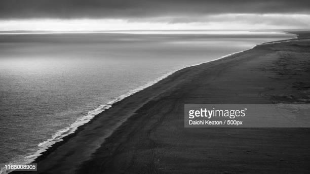 dusk on black sand beach - punalu'u_beach stock pictures, royalty-free photos & images