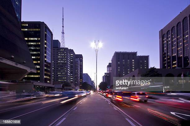 dusk on paulista avenue in brazil with blurred cars - são paulo stock pictures, royalty-free photos & images