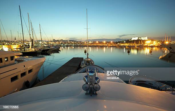 dusk over antibes harbour - antibes stock photos and pictures