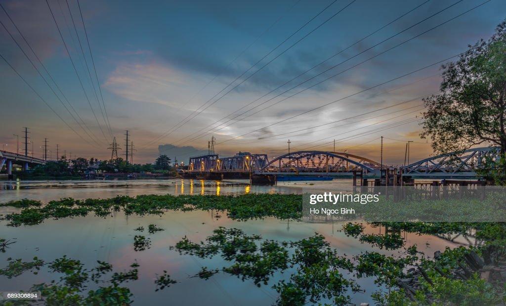 Dusk over Binh Loi Bridge new and old by night, Ho Chi Minh City, Vietnam : Stock Photo