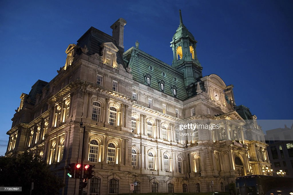 Dusk photograph of the Hotel de Ville (city hall) building in Montreal, Quebec, Canada. : Photo