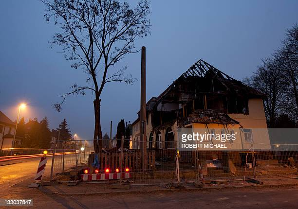 Dusk sets at the debris of the burnt house of selfconfessed neoNazi 36yearold woman Beate Z in Zwickau eastern Germany on November 16 2011 Beate Z...