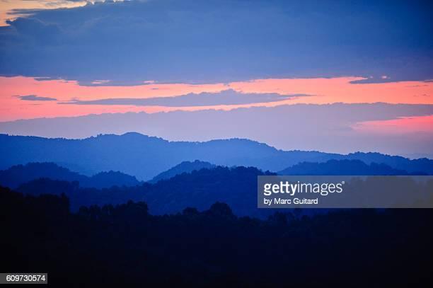 Dusk settles over the rugged landscape of Bwindi Impenetrable National Park, Uganda.