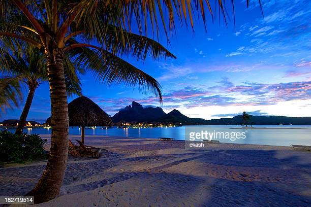 dusk settling in bora-bora - french polynesia stock pictures, royalty-free photos & images