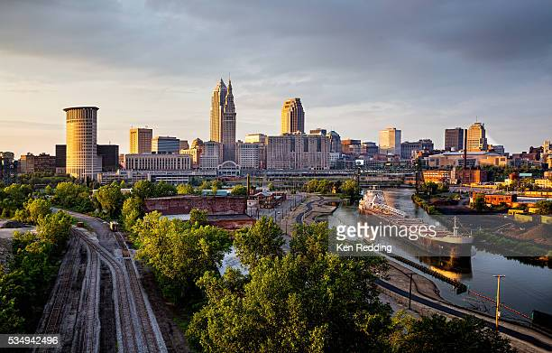 Dusk skyline of downtown Cleveland Ohio with freighter on the Cuyahoga River