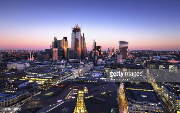 dusk till dawn cityscape of london - multiple exposure - skyline stock pictures, royalty-free photos & images