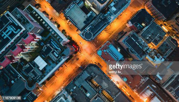 dusk view of a road intersection in downtown shanghai, china - cross shape stock pictures, royalty-free photos & images