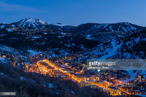 dusk view of park city glowing - park city utah stock pictures, royalty-free photos & images
