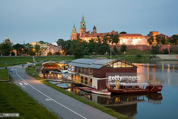 dusk view of the wawel castle and the wawel cathedral towers across the vistula river in krakow, poland, eastern europe - wawel cathedral stock pictures, royalty-free photos & images