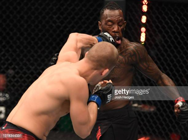 Dusko Todorovic of Serbia punches Dequan Townsend in their middleweight bout during the UFC Fight Night event inside Flash Forum on UFC Fight Island...