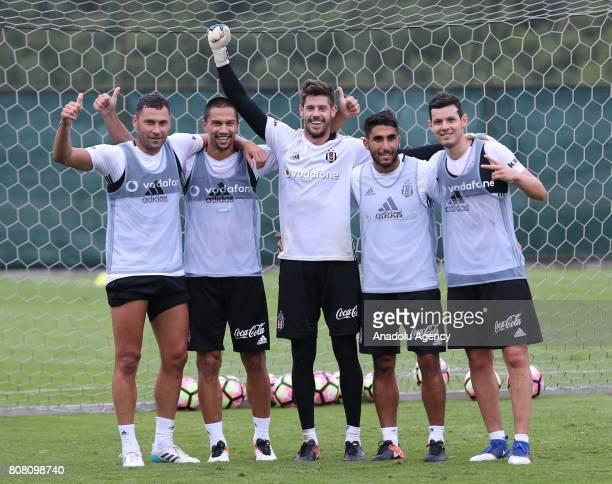 Dusko Tosic Gokhan Inler Fabricio Agosto Ramirez Aras Ozbiliz and Pedro Franco of Besiktas attend the team's training session within the preparations...