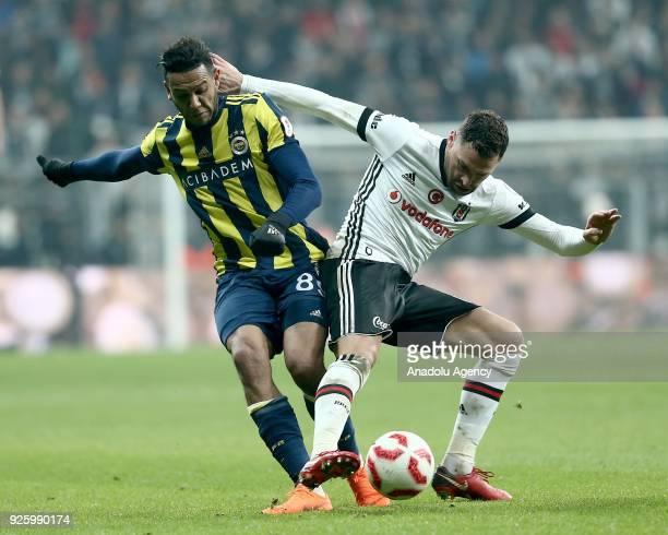 Dusko Tosic of Besiktas in action against Josef De Souza of Fenerbahce during a Ziraat Turkish Cup semi final first leg soccer match between Besiktas...