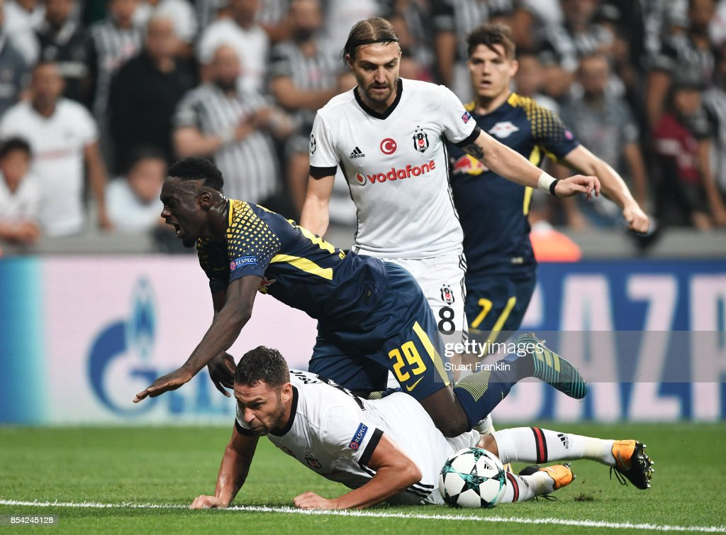 Dusko Tosic of Besiktas tackles Jean-Kevin Augustin of RB Leipzig during the UEFA Champions League Group G match between Besiktas and RB Leipzig at Besiktas Park on September 26, 2017 in Istanbul, Turkey.