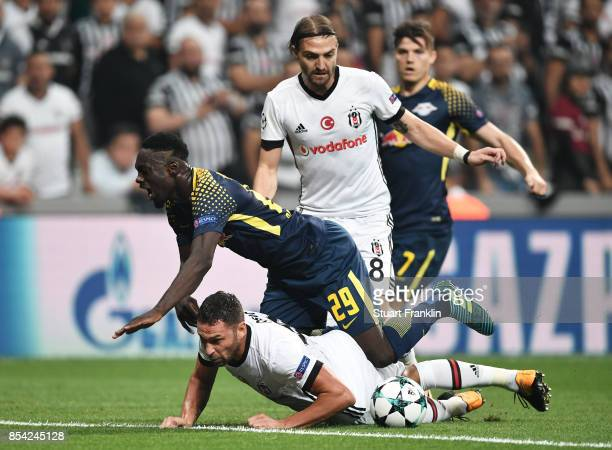 Dusko Tosic of Besiktas tackles JeanKevin Augustin of RB Leipzig during the UEFA Champions League Group G match between Besiktas and RB Leipzig at...