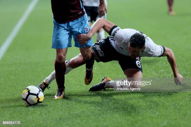 Dusko Tosic of Besiktas vies with Jan Durica of Trabzonspor during the Turkish Super Lig soccer match between Besiktas and Trabzonspor at Vodafone...