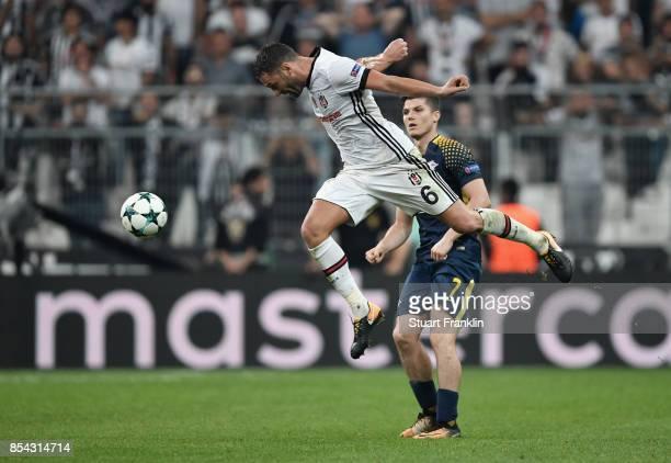 Dusko Tosic of Besiktas wins a header during the UEFA Champions League Group G match between Besiktas and RB Leipzig at Besiktas Park on September 26...