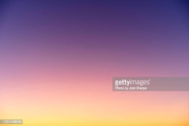 dusky sky gradient horizontal - orange sky stock pictures, royalty-free photos & images