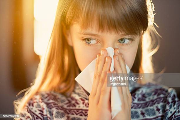 Dust allergy - little girl cleaning runny nose