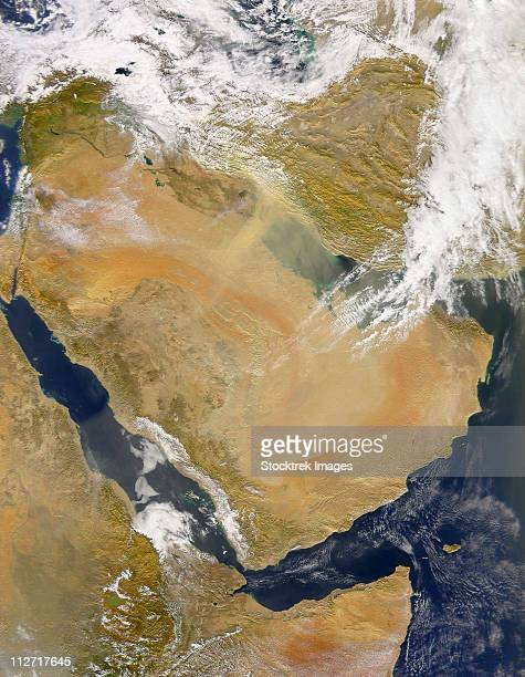Dust and Smoke over Iraq and the Middle East. Also visible are a few plumes of dark smoke over the Fertile Crescent to the east of Lake Razazah.