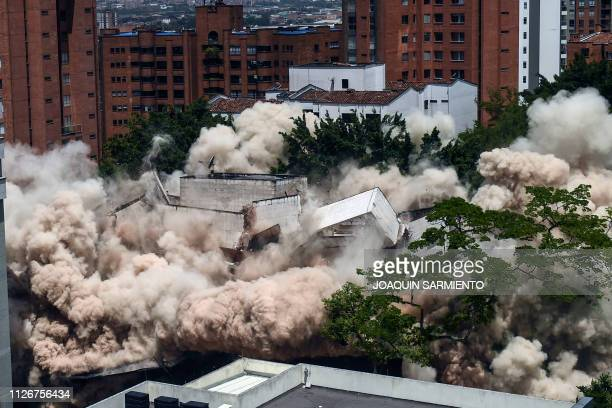A dust cloud engulfs the area during the demolition of the Monaco building which was once home to Colombian drug lord Pablo Escobar in Medellin...