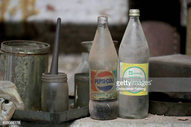 Dust covered soft drinks bottles sit in the hidden fire station of a Black Country factory on February 13 2017 in Dudley England A fire station that...