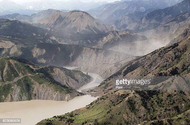 Dust created by a strong aftershock hangs above the Clarence River which was blocked causing a huge dam north of Kaikoura on November 14 2016 in New...