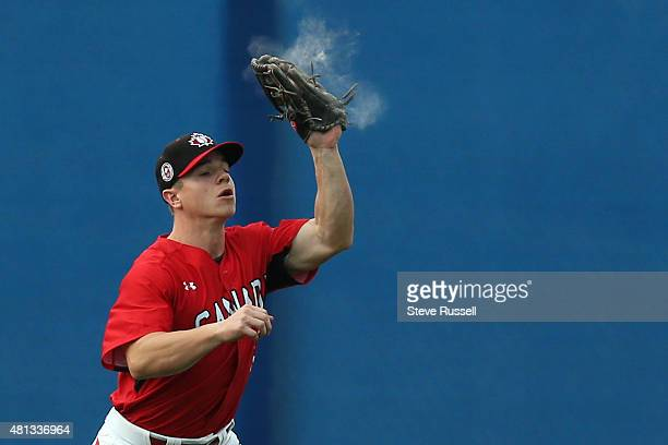 AJAX ON JULY 19 Dust explodes from Tyler O'Neill's glove as he makes an out as Team Canada beats Team USA in extra innings in the Pan Am Games...