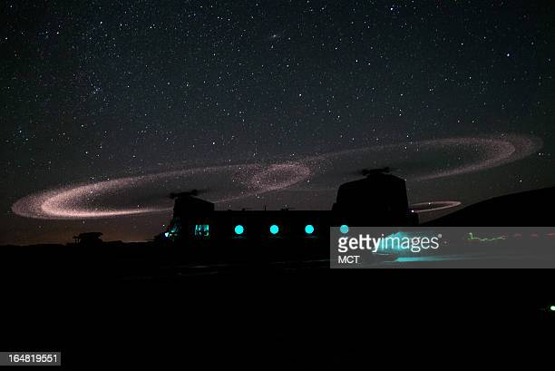 Dust lights up the rotors of a CH47 Chinook helicopter as paratroopers with 3rd Squadron 73rd Cavalry Regiment load for an air assault mission near...